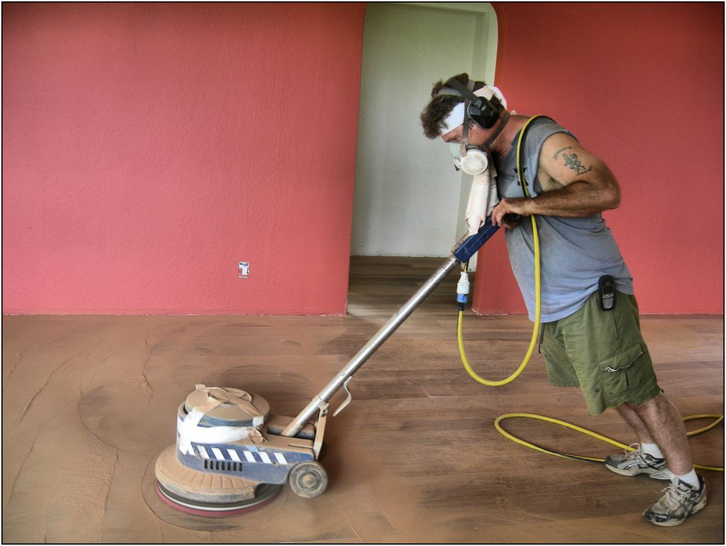 floor sanding with safety equipment